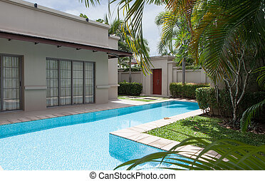 view of nice modern villa with swimming pool