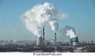 thermal power station - View of of smoking chimneys of...