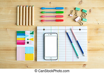 View of office or educational supplies on wooden table