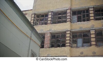 View of old abandoned building without glass in windows....