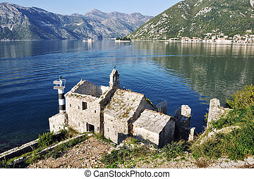Church of the Lady of Angels constructed in 1585 in Boka Kotorska bay, Montenegro with view at the sea and mountains