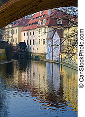 View of old Prague waternill wheel on Chertovka river
