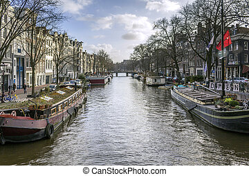 View of one of the Unesco world heritage famous city canals (Prinsengracht) of Amsterdam, The Netherlands.