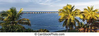 Florida Keys - View of Overseas Highway framed by palm trees...