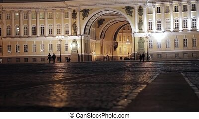 View of Palace square in Saint Petersburg in night. In love couples silhouettes.
