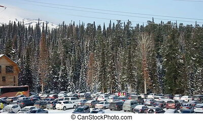 View of parking on the winter mountain at ski resort