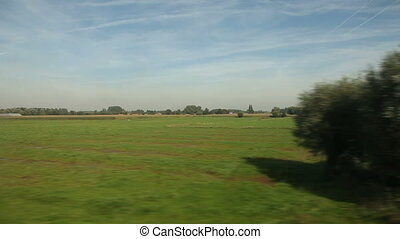 View of passing landscape from a train window