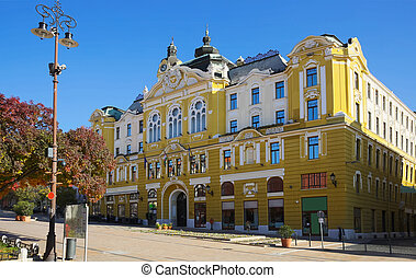 View of Pecs City Hall in Szechenyi square in sunny autumn day, Hungary