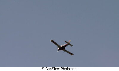 View of plane flying and its board shines on sun