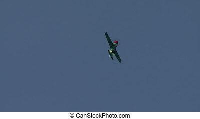 View of plane performs aerobatics loop - View of...