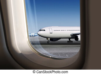 view of plane through window - view of plane on runway...
