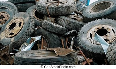 View of plenty of weathered car tires ready for recycling -...