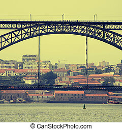 view of Porto, Portugal with the famous Dom Luis bridge over...