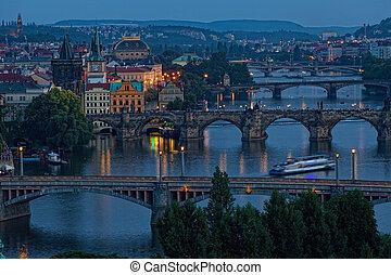 View of Prague at night: river Vltava and bridges
