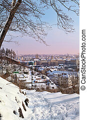View of Prague's Old Town from Chotek gardens in winter with snow