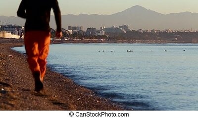 view of public beach and calm sea at the sunrise in Antalya, Turkey.