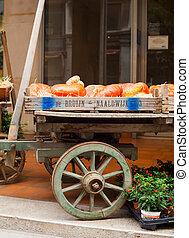 Pumpkins on vintage wooden cart