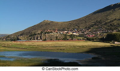 View Of Puno Cathedral From Lake Titicaca, Peru - Wide low...