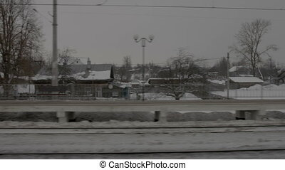View of railway station from moving train