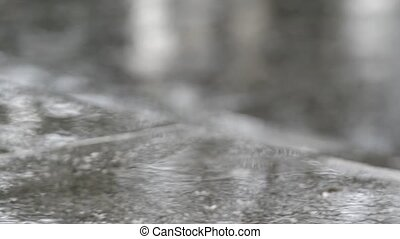 Raindrops Falling On The Puddle - View Of Raindrops Falling...