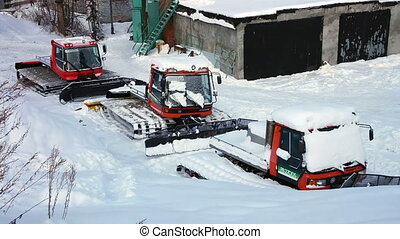 View of ratrak tractor machines at ski resort