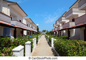 view of resort on coast. three-storey villas with balconies