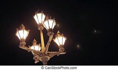 View of retro flashlight in night city.