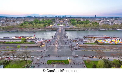 View of river Seine, Trocadero and La Defense from the Eiffel tower. Day to night timelapse. Paris, France, Europe.
