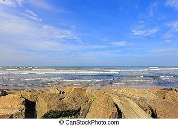 View of rocks on the ocean beach