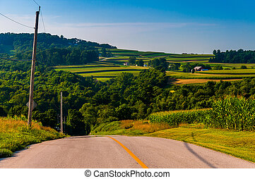 View of rolling hills and farms from a country road in York County, Pennsylvania.