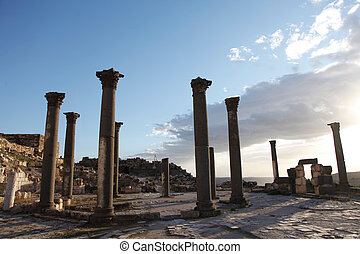 View of Roman Columns & a dramatic cloudy Sky
