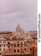 View of roofs and churches domes in Rome from Pincio hill, Italy