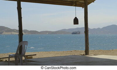 View of sea from beach shack in Papua new guinea - A clear...