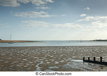 View of sea shore with tide out at Brightlingsea, Essex