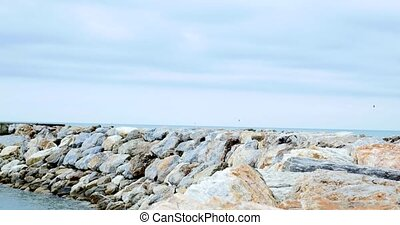 View of sea with rocks and little waves.