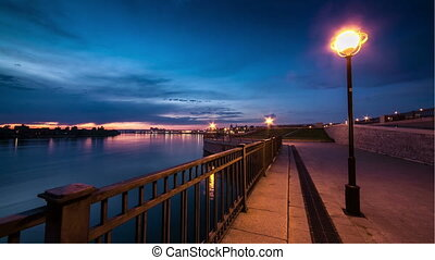 View of seafront in night city. Illumination. - View of...