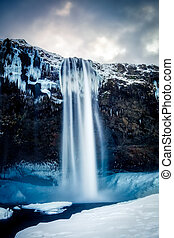 View of Seljalandfoss Waterfall in Winter