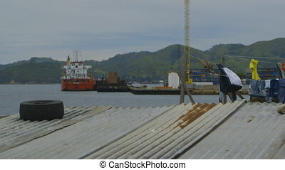 View of ships from a floating village, Moresby