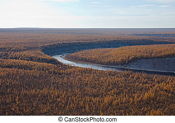 View of Siberian river in the fall from the helicopter