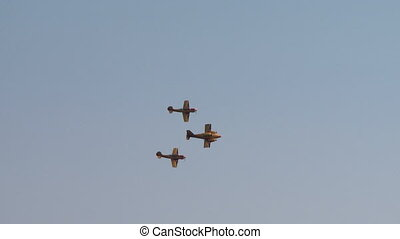 View of single-engine planes fly in formation