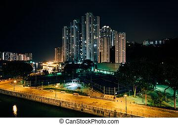 View of skyscrapers in Aberdeen from the Ap Lei Chau Bridge at night, in Hong Kong, Hong Kong.