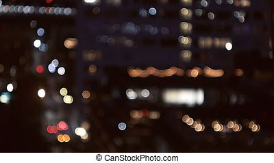 View of skyscrapers of New York lit up at night. above of...