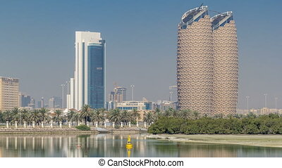 View of skyscrapers skyline with Al Bahr towers in Abu Dhabi...
