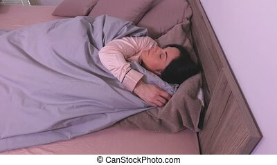 View of sleeping woman in bed