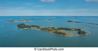 View of Small Island on the Ocean with Clear Skies