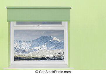 View of snow covered mountains from window