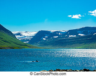 View of snow mountain and the lake in summer