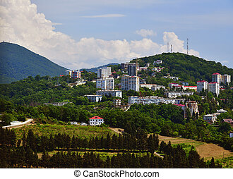 View of Sochi on background of Caucasian mountains in Russia.