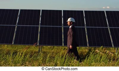 View of solar energy panels installed in the field on...