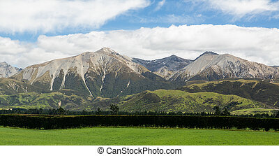 View from the train windows of Tranz Alpine railway that climbs the Southern Alps in New Zealand towards Arthurs Pass